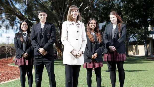 A for effort: St Albans Secondary College principal Kerry Dowsley poses for a photo with students Francisco Passadore-Rocha, Christie Vo, Brigitte Thomas and Nikolina Arnaut on the school grounds. Photo: Wayne Taylor/ Fairfax Media
